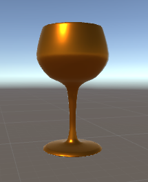A bronze-colored cup that looks like a wine glass.