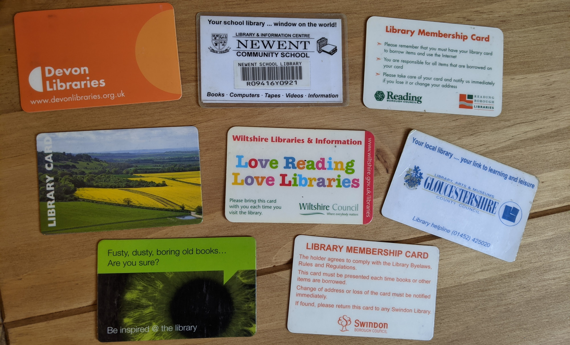 A set of library cards including a school library and 7 other library services