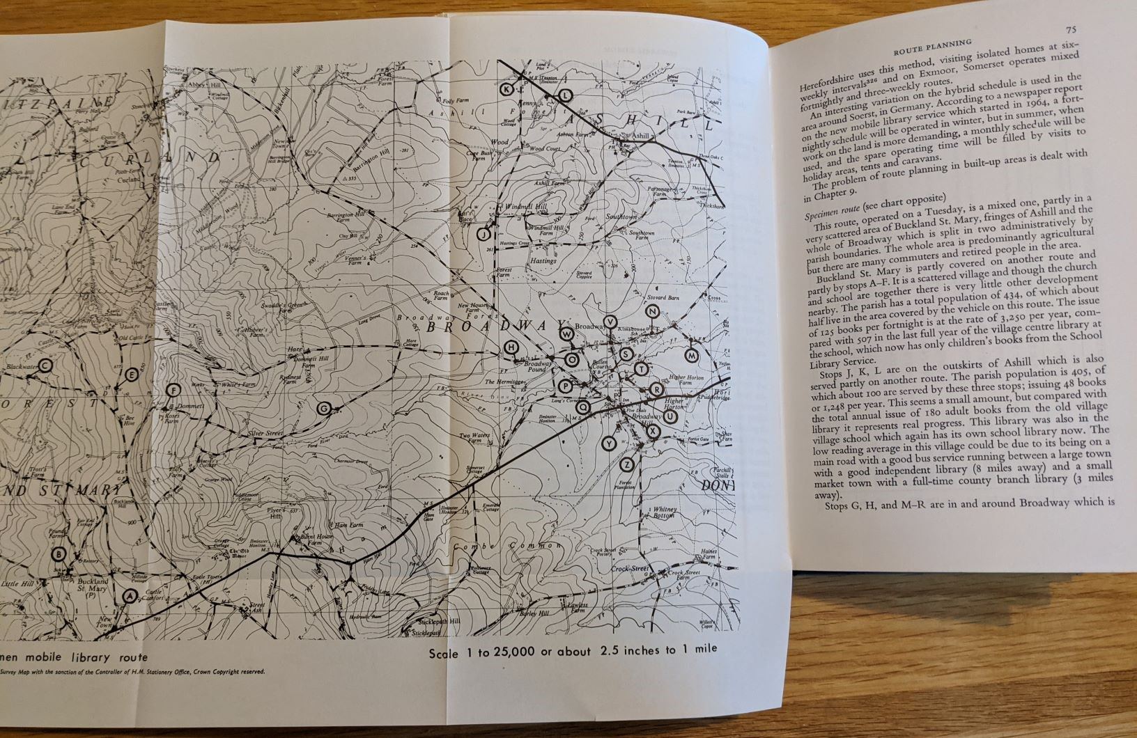 Mobile libraries book opened at the pull-out map pages