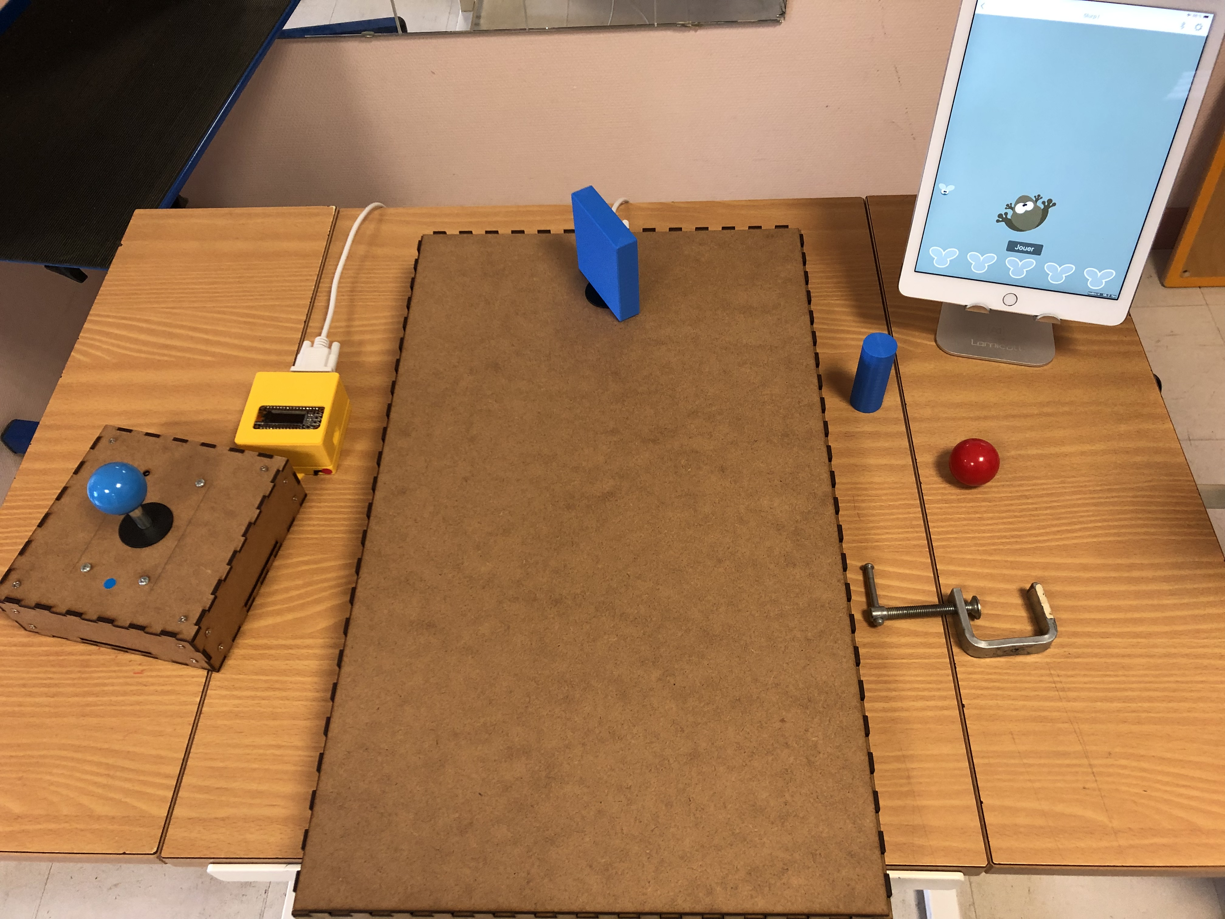 Set up with plates and joystick plugged to the box connected to the iPad