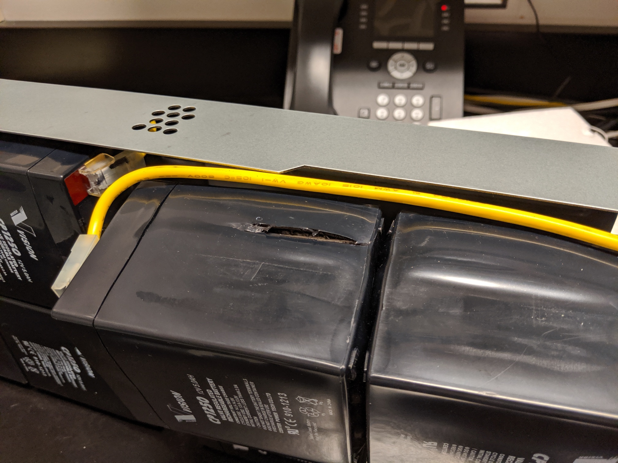Old batteries bulging and cracking