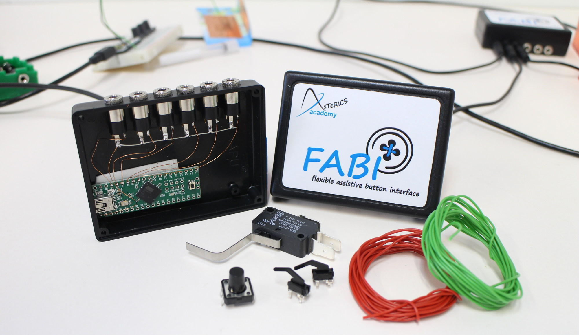 An opened FABI box, where you can see the Teensy microcontroller board and the 6 jackplugs