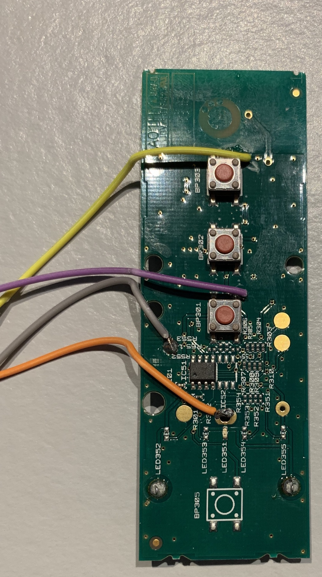 Logic board with soldered wires