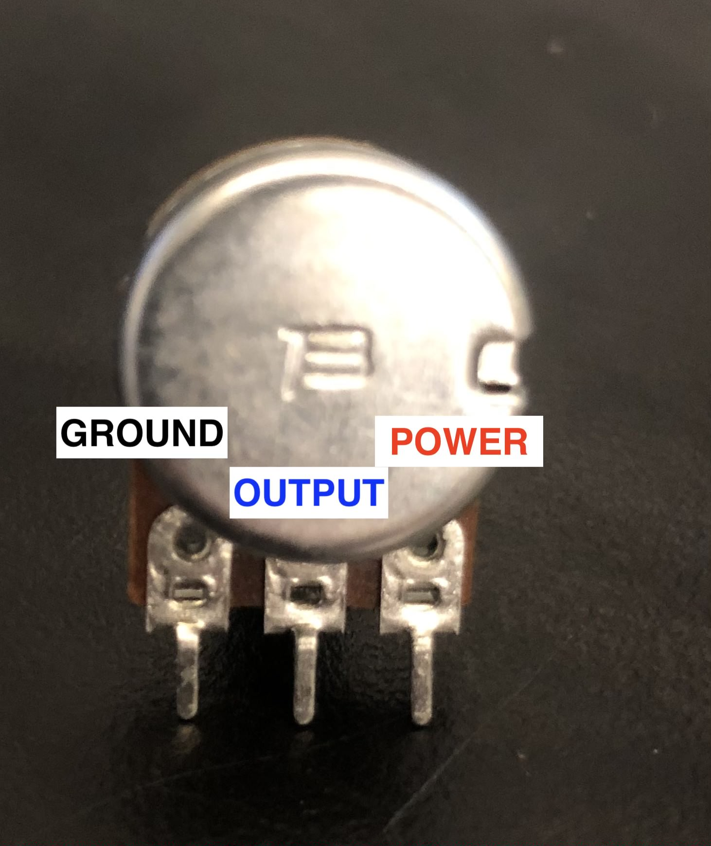 a diagram of a potentiometer with three pins: from left to right, ground, output, and power