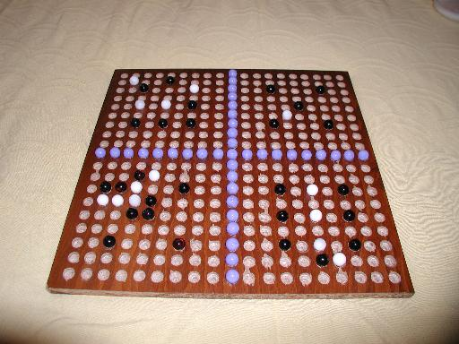 Four 9x9 handicap games on a marble go board