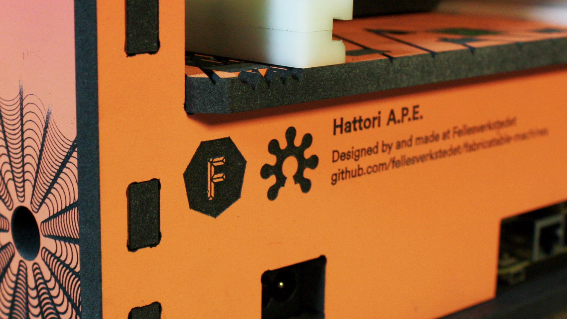 The open source hardware logo has been hacked to match the chamfer rail roller pinion