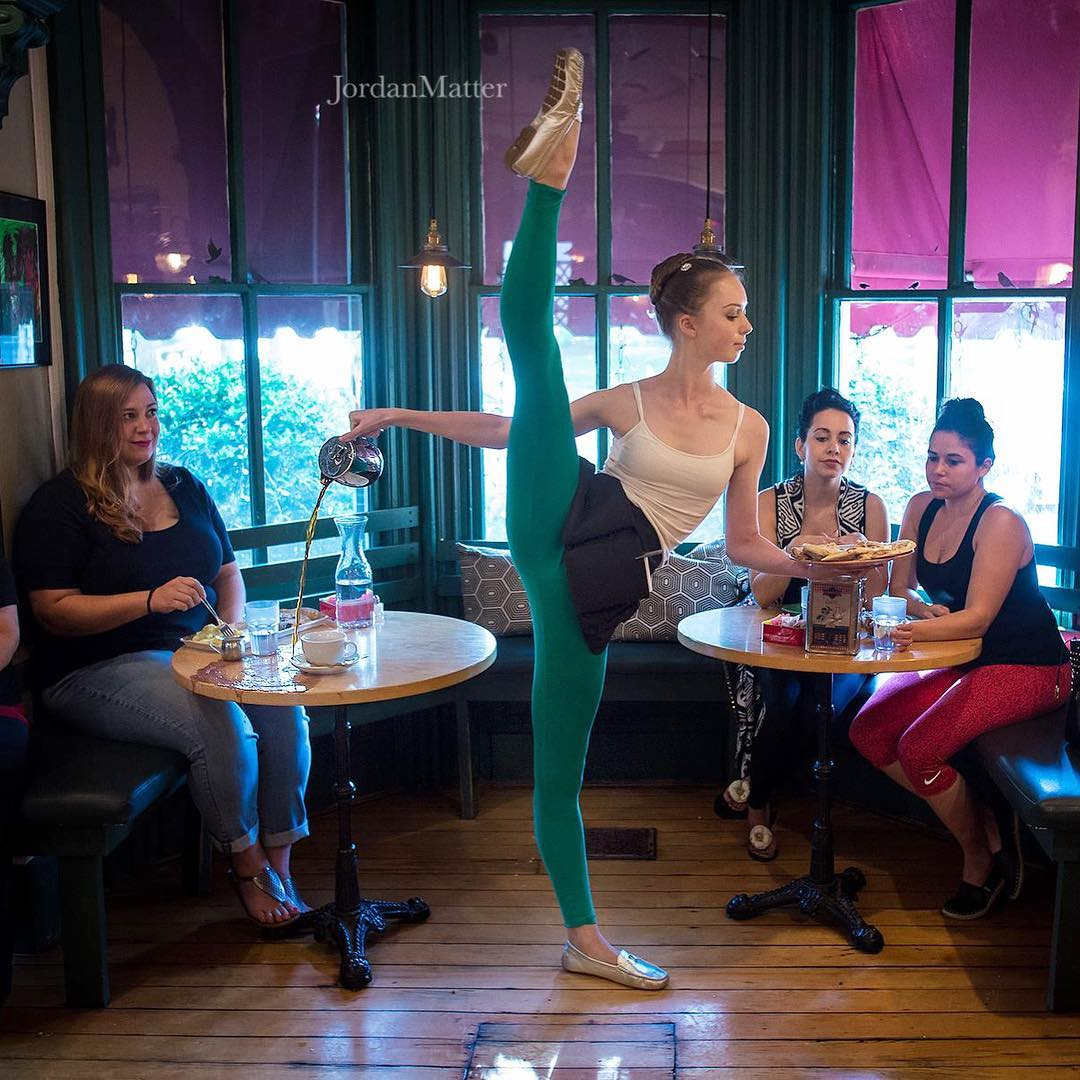silly dance scene of a ballerina trying to wait tables