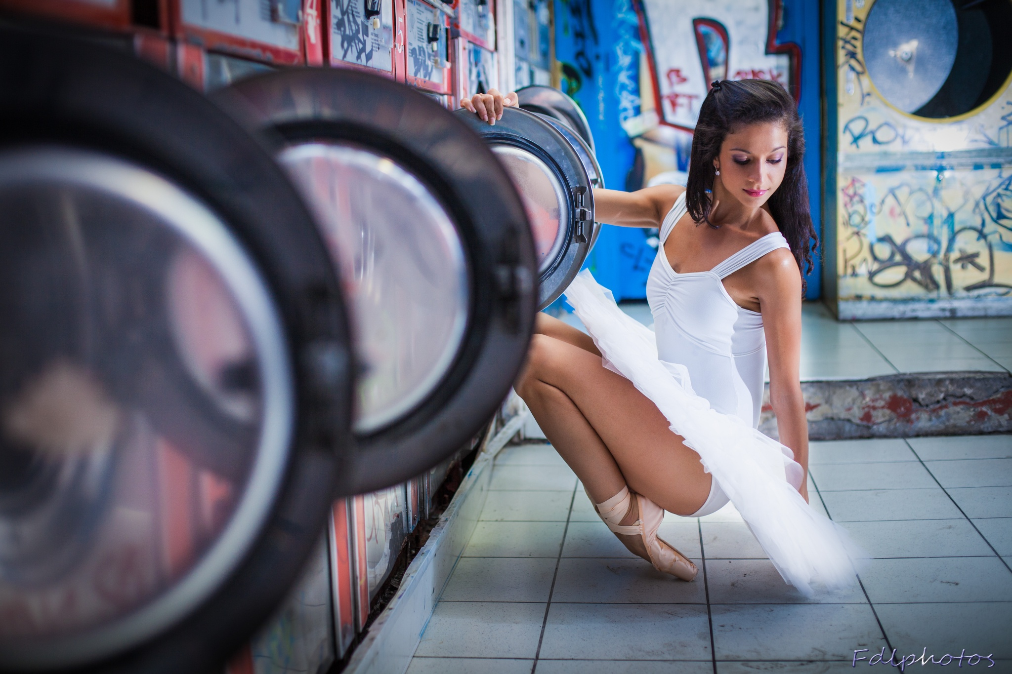 a ballerina in a laundromat