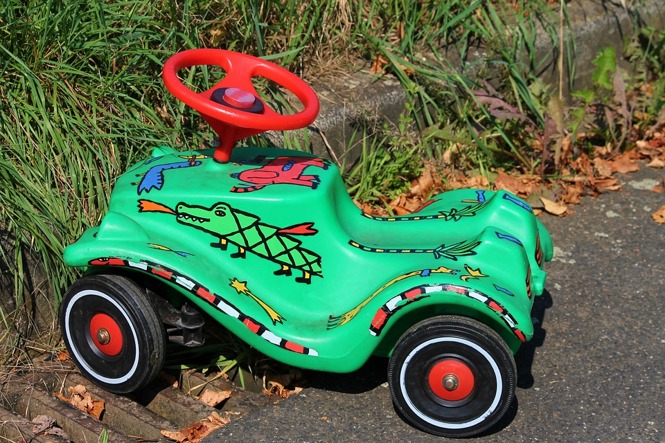 toy car with fire breathing shoe wearing alligator painted on