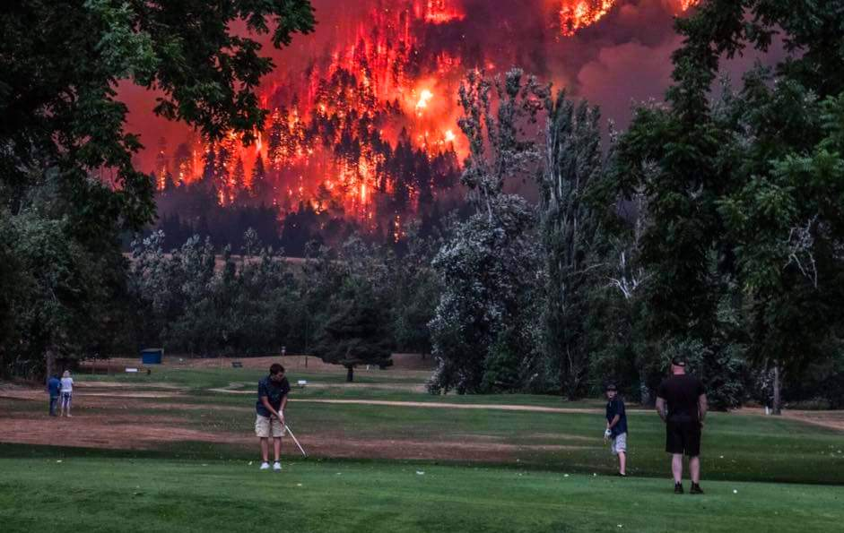 people play golf while the world burns