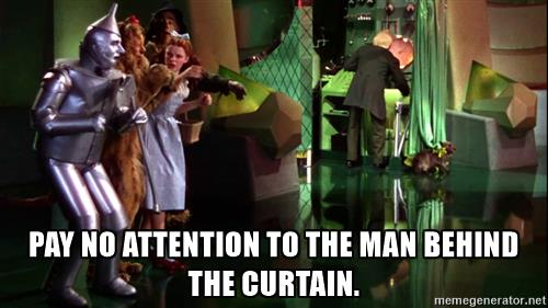 """Still image from Wizard of Oz movie with quote """"Pay no attention to the man behind the curtain!"""""""
