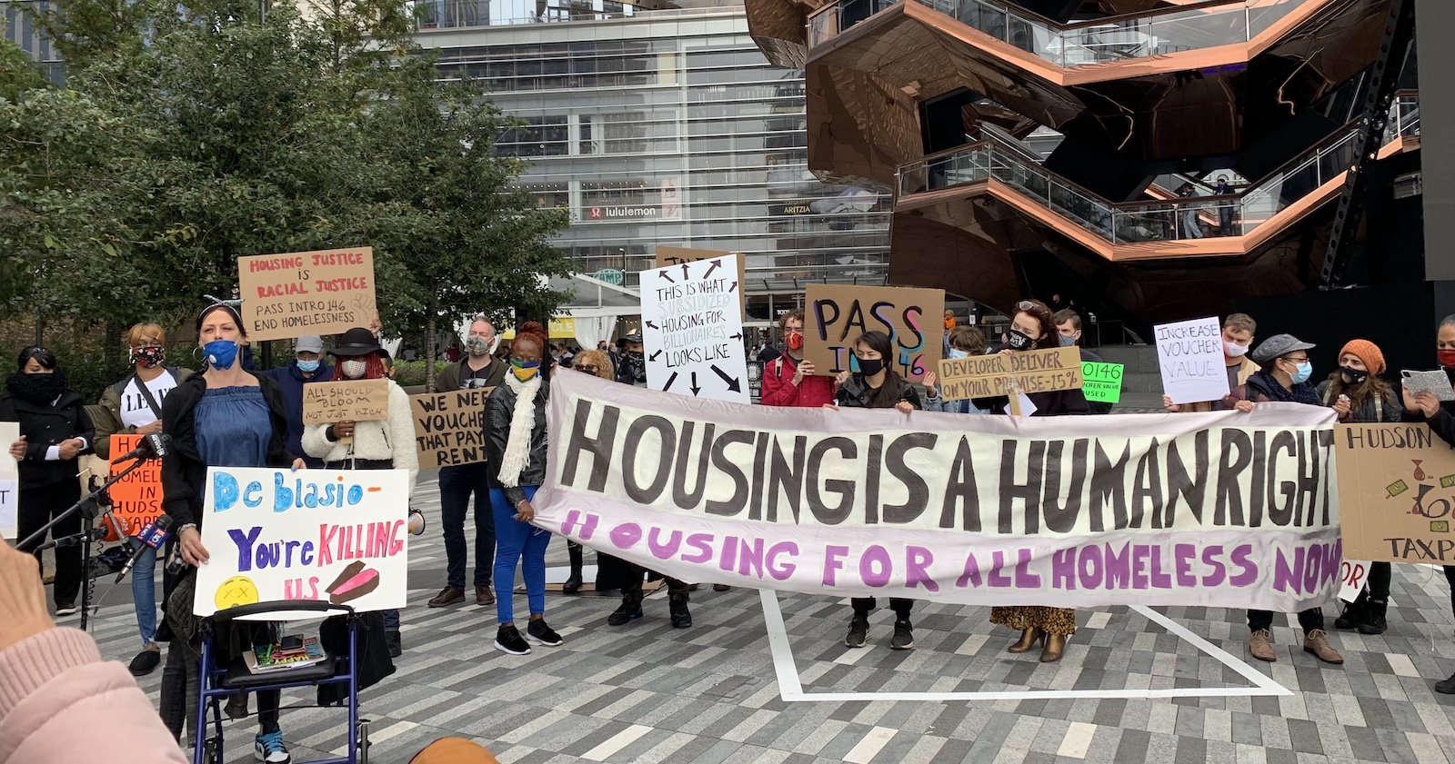 Housing action, protest at Hudson Yards with banners, housing is a human right