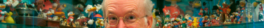 keno don rosa among his collection of ducks, only his eyes visible