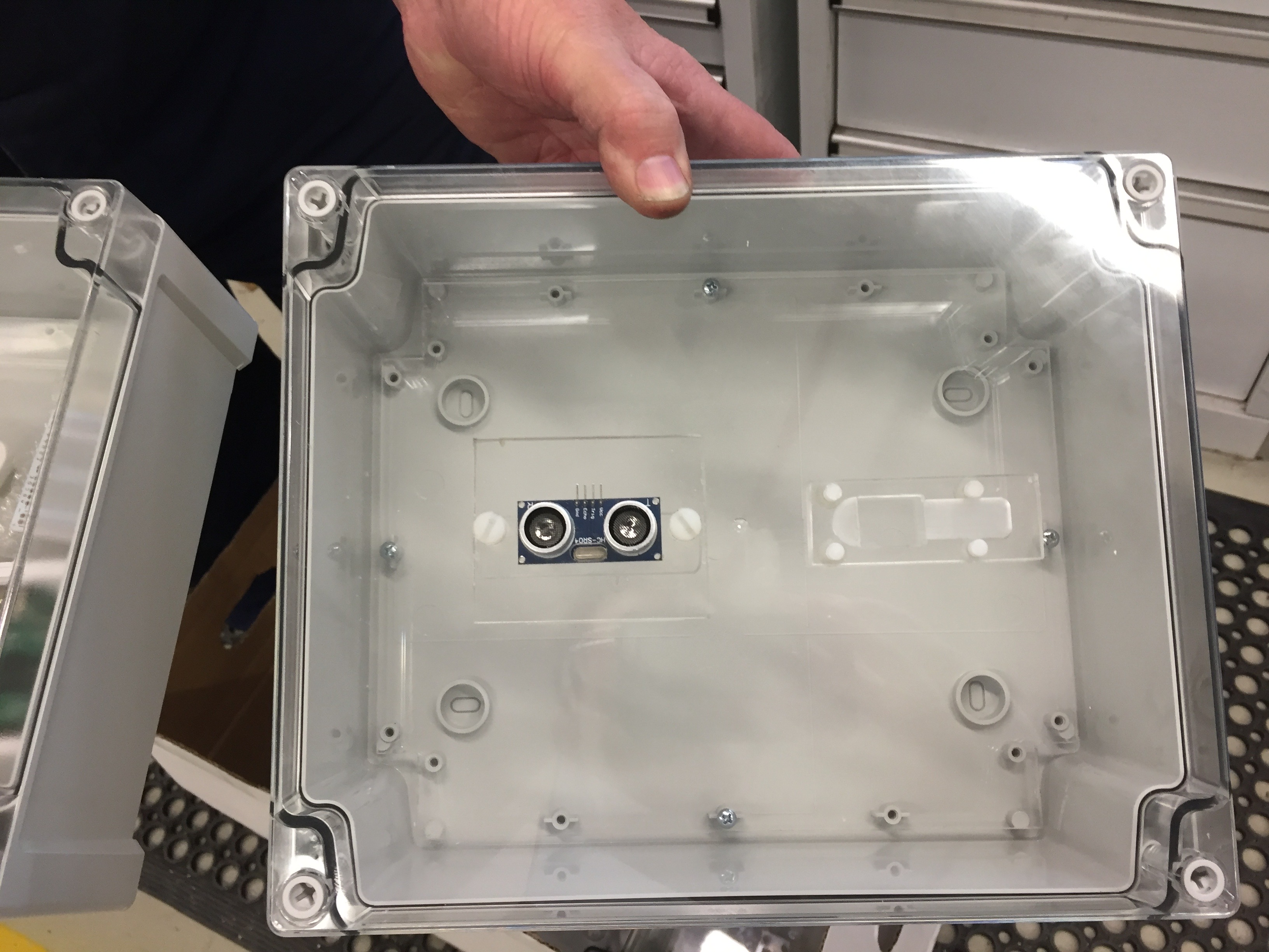 Box with sonar sensor in its compartment.