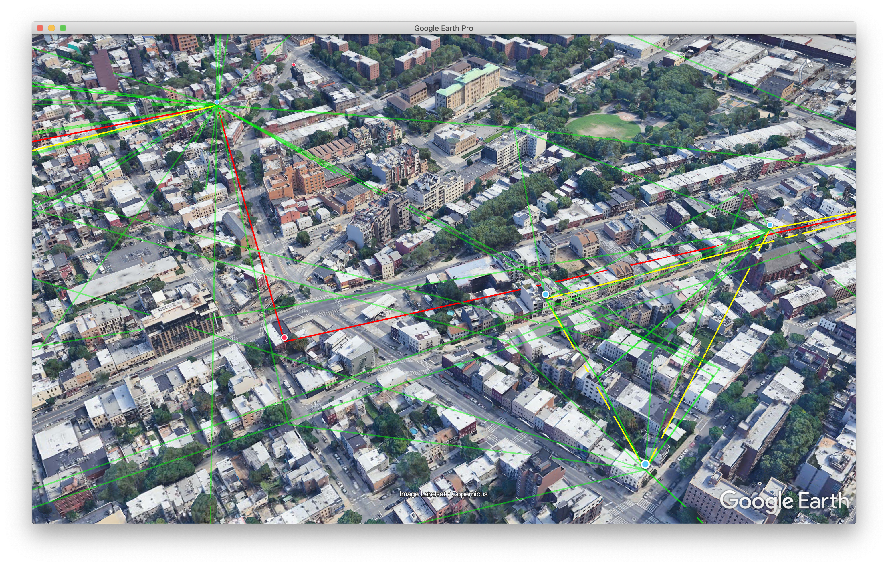Screenshot of Google Earth showing data from Mesh API. There are blue dots showing nodes on buildings and green and yellow lines showing links between nodes.