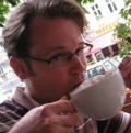 Photo of Mark Reid drinking a coffee