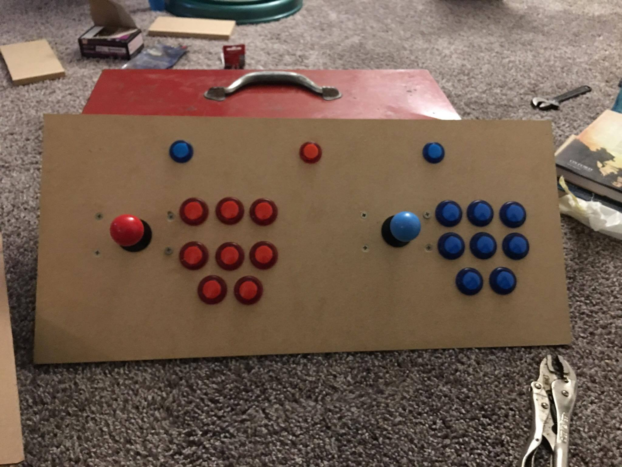 The Front of the arcade panel with buttons and joy stick added. Buttons are two rows of three and one row of two buttons