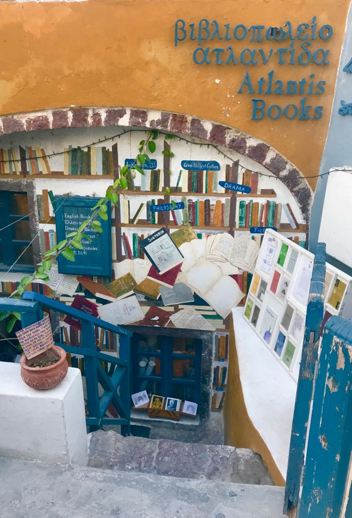 Atlantis books from the outside showing the entrance, the steps down to it and all the books around it
