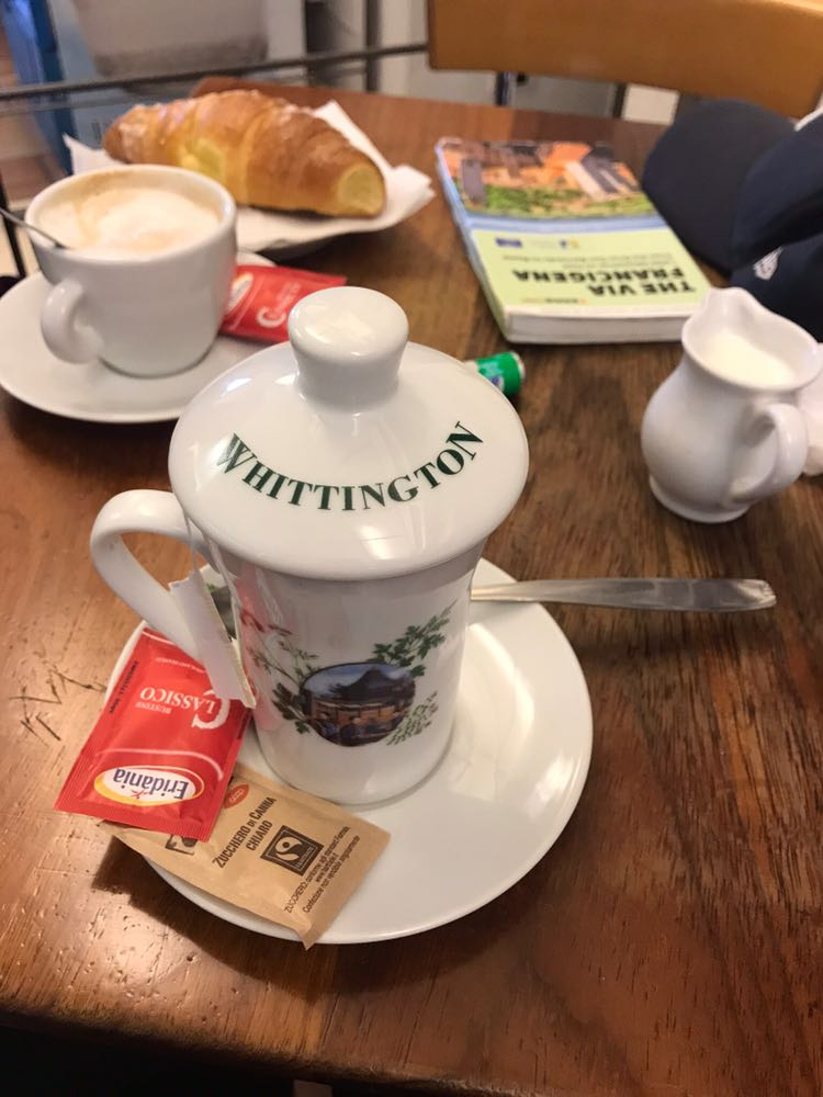 Tea, coffee and pastries for breakfast at a cafe in Italy