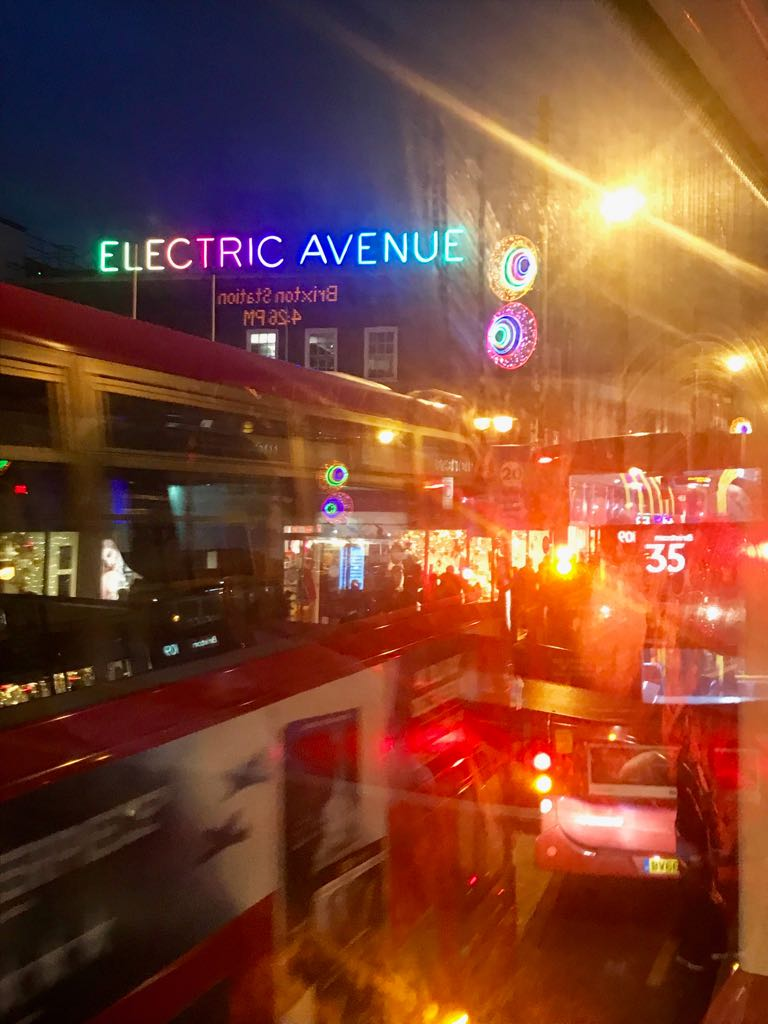 The lights of Electric Avenue, as seen from the top deck of a bus in Brixton
