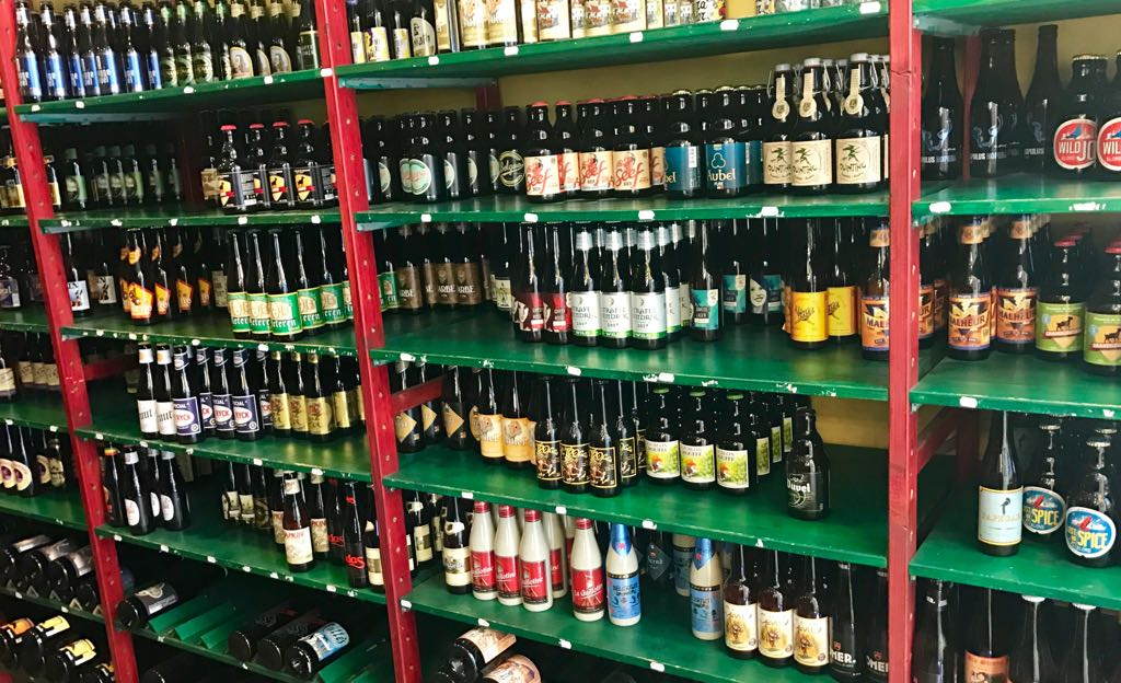 shelves of different beers in a beer shop