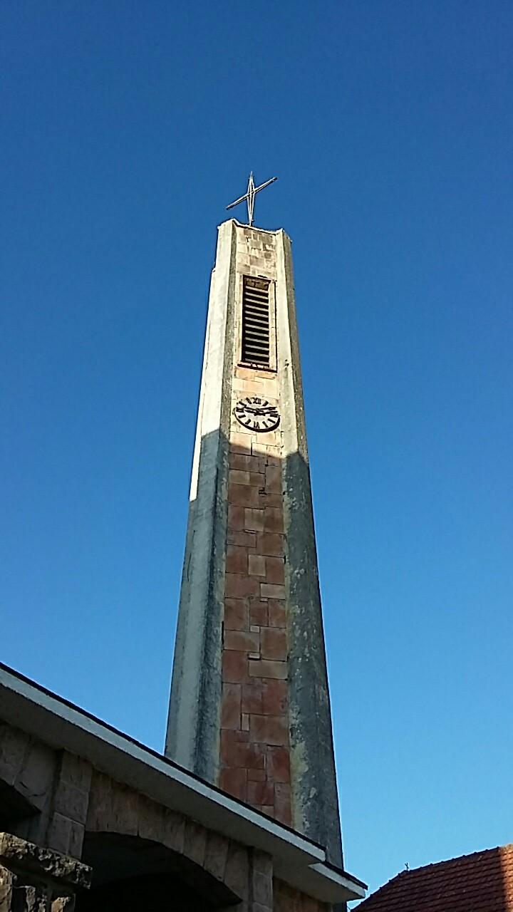 The spire of a church in the town of Burguete