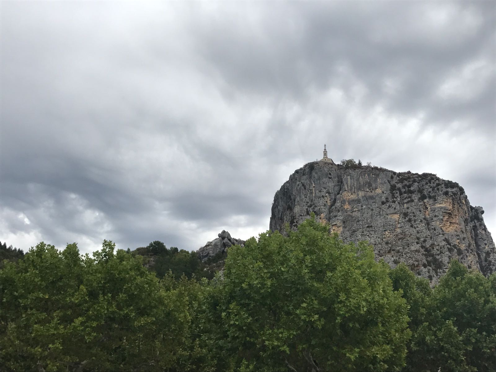 A church at the top of a mountain overlooking Castellane