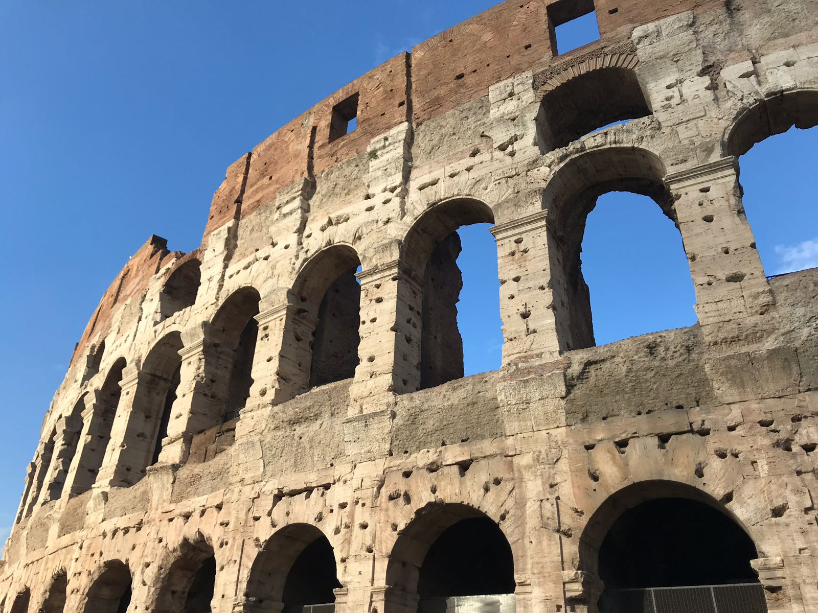 The Colosseum in Rome from the outside showing arches with less reconstruction completed
