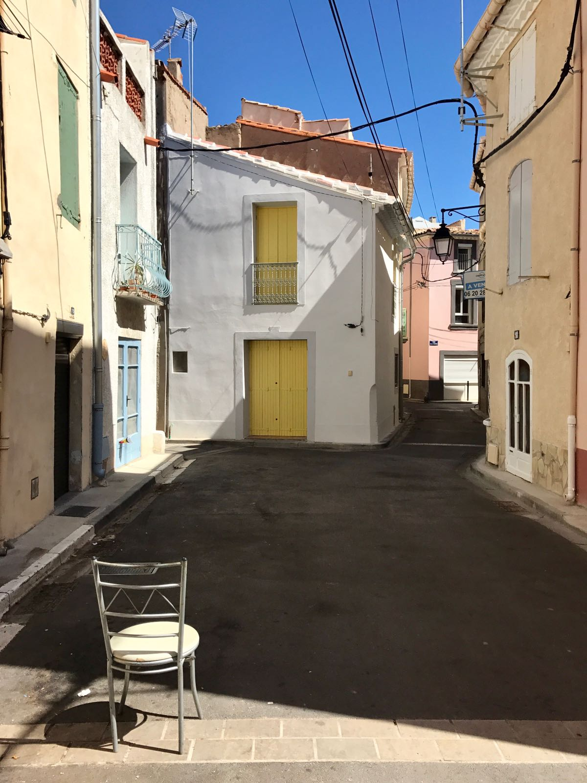 A street in Marseillan showing the colourful doors and shutters the houses have