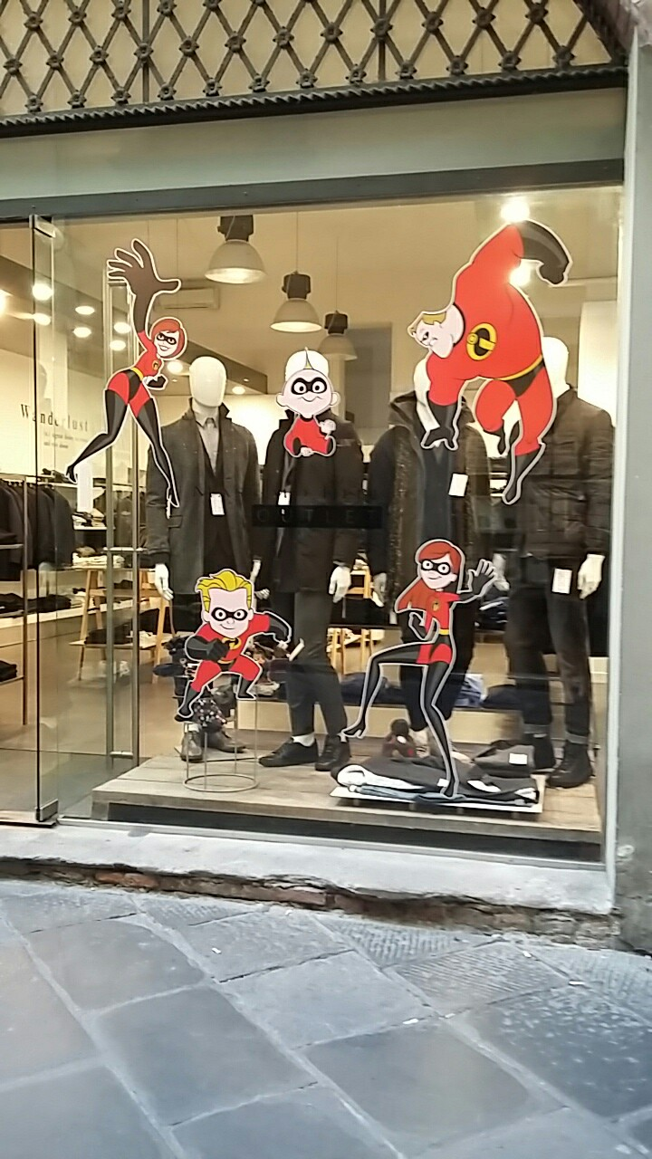 Clothes shop display with Incredibles stickers on the glass