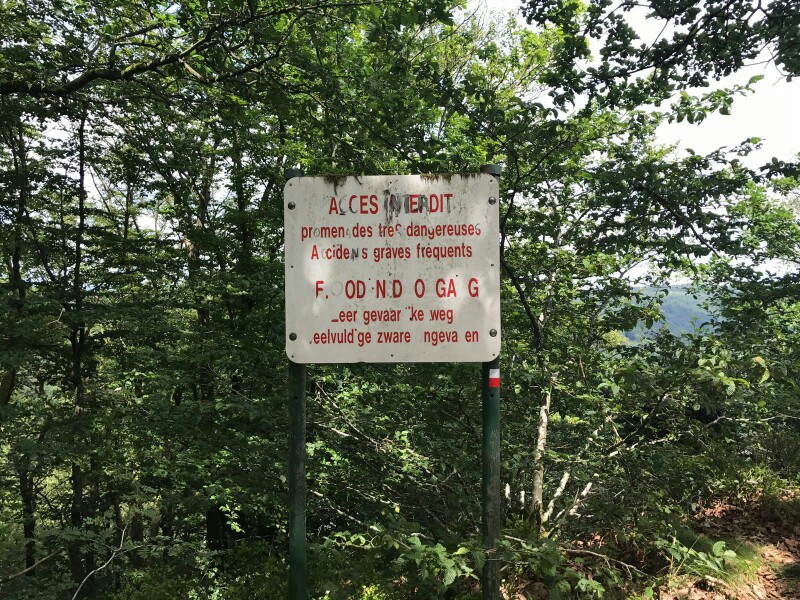 Sign warning of hazards on a walking path