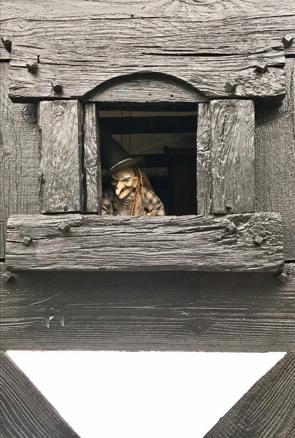creepy, Grimm fairy tales puppet in a tiny Black Forest window