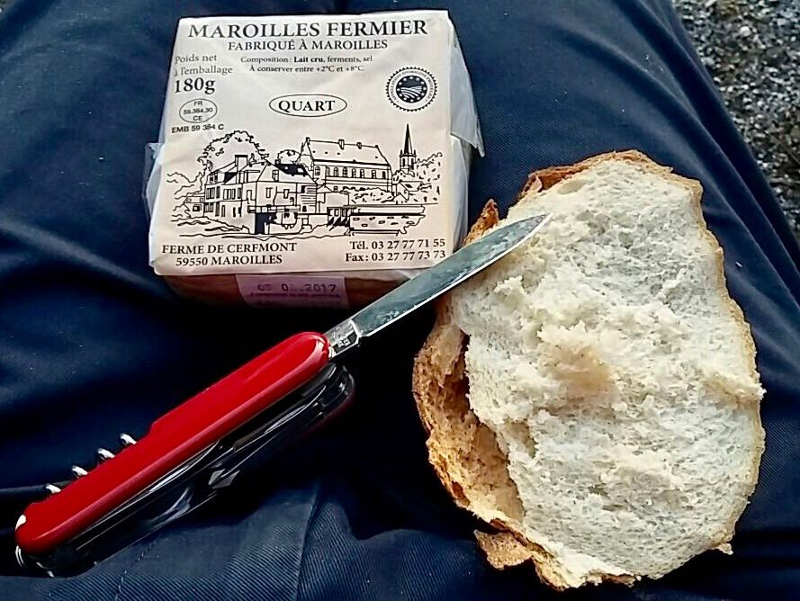delicious maroilles cheese, swiss army knife and bread on tom's lap