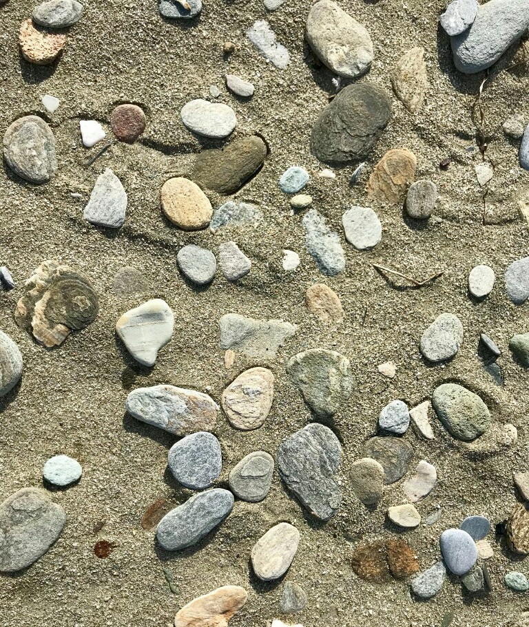 A selection of very flat stones on the beach near Chora