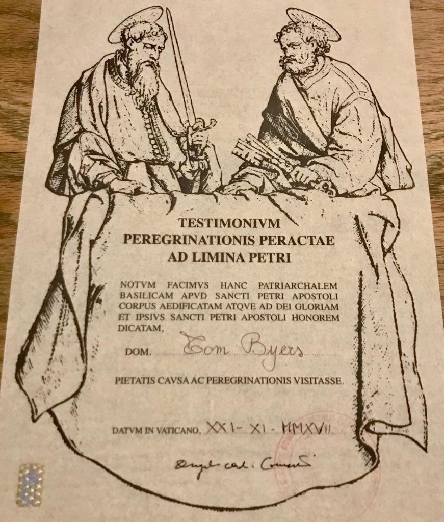 Tom's certificate showing he finished the Francigena with what looks like two monks standing over a scroll with his details on