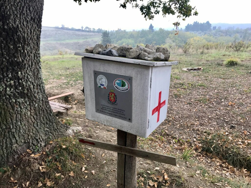 Box of medical supplies on a post along the side of the walking path