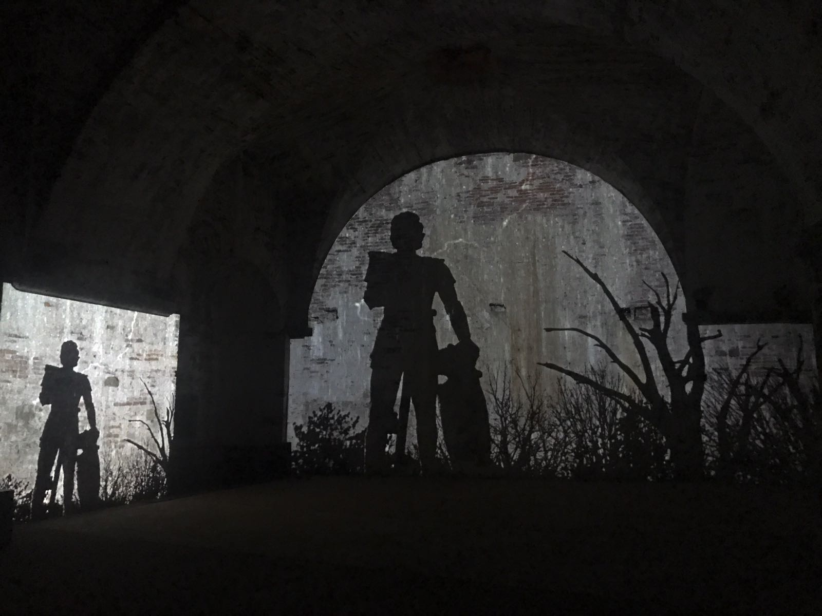 Projections from the story of the Francigena showing a silhouette of a knight