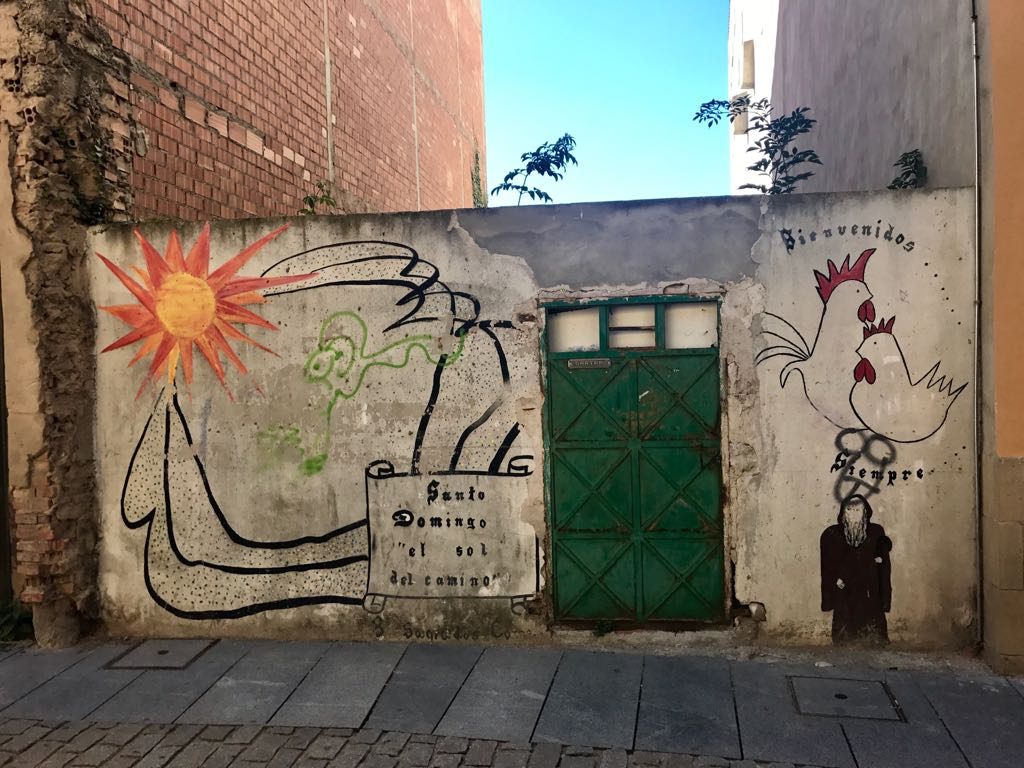 Graffiti in Santo Domingo featuring a chicken and a rooster