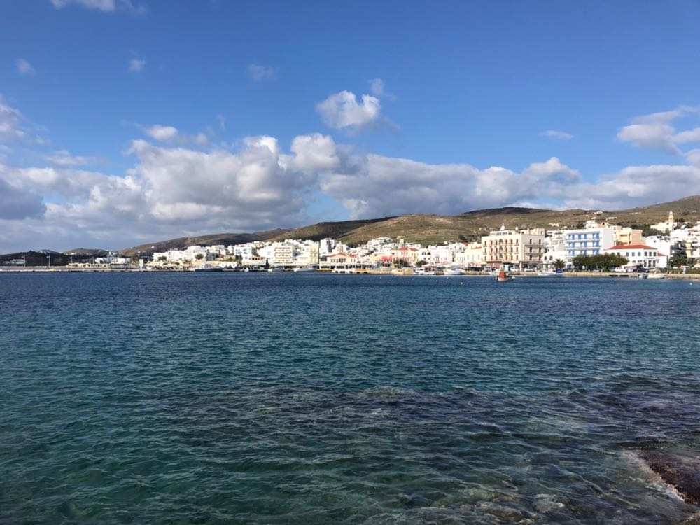 Tinos town harbour seen from across the clear water