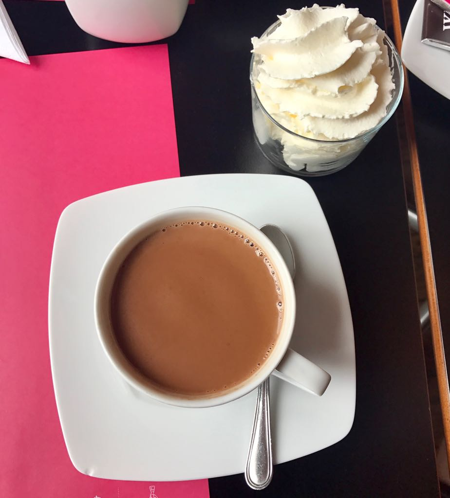 hot chocolate with separate cup of chantilly cream