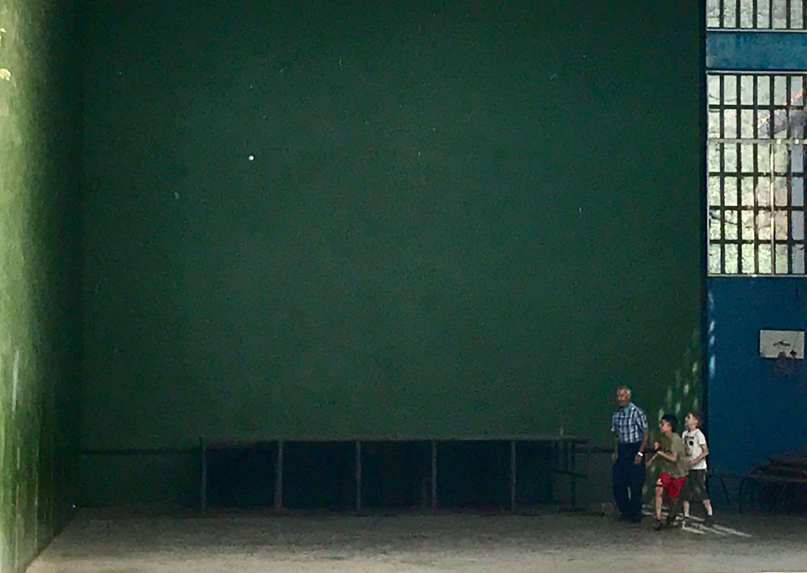 Kids playing handball with an local man