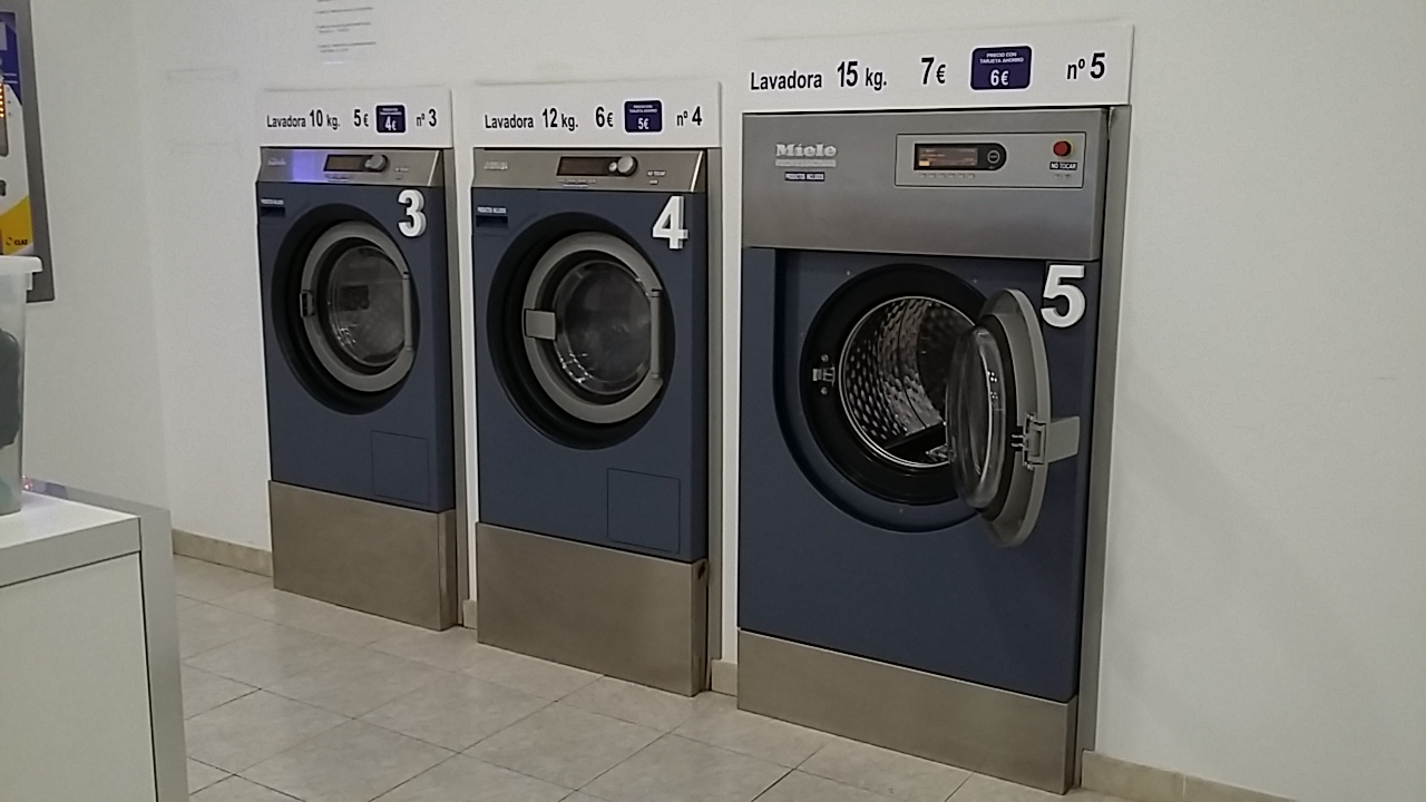 The different sizes of washing machine, all marked with the weight they can take and how much a wash costs