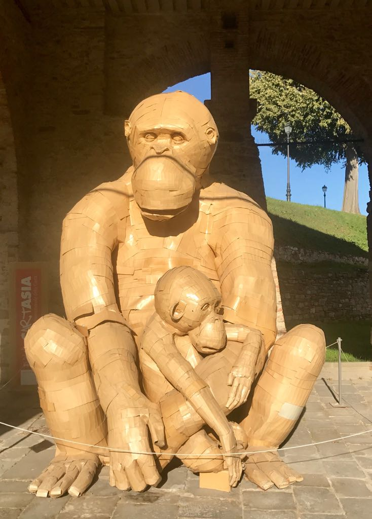 Sculpture of a monkey and her baby made from cardboard