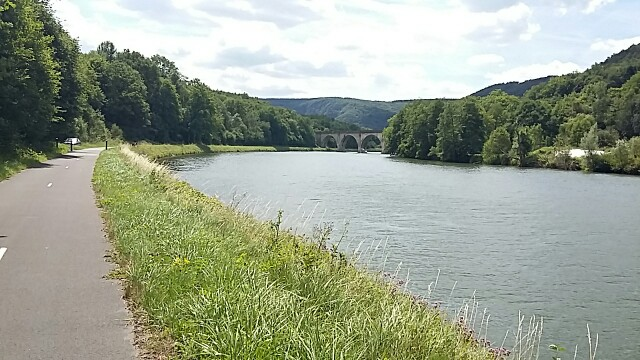 The river meuse crossed by a stone bridge