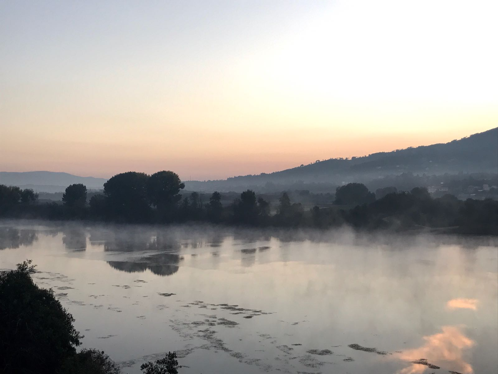 The miňo river at sunrise, from Tui