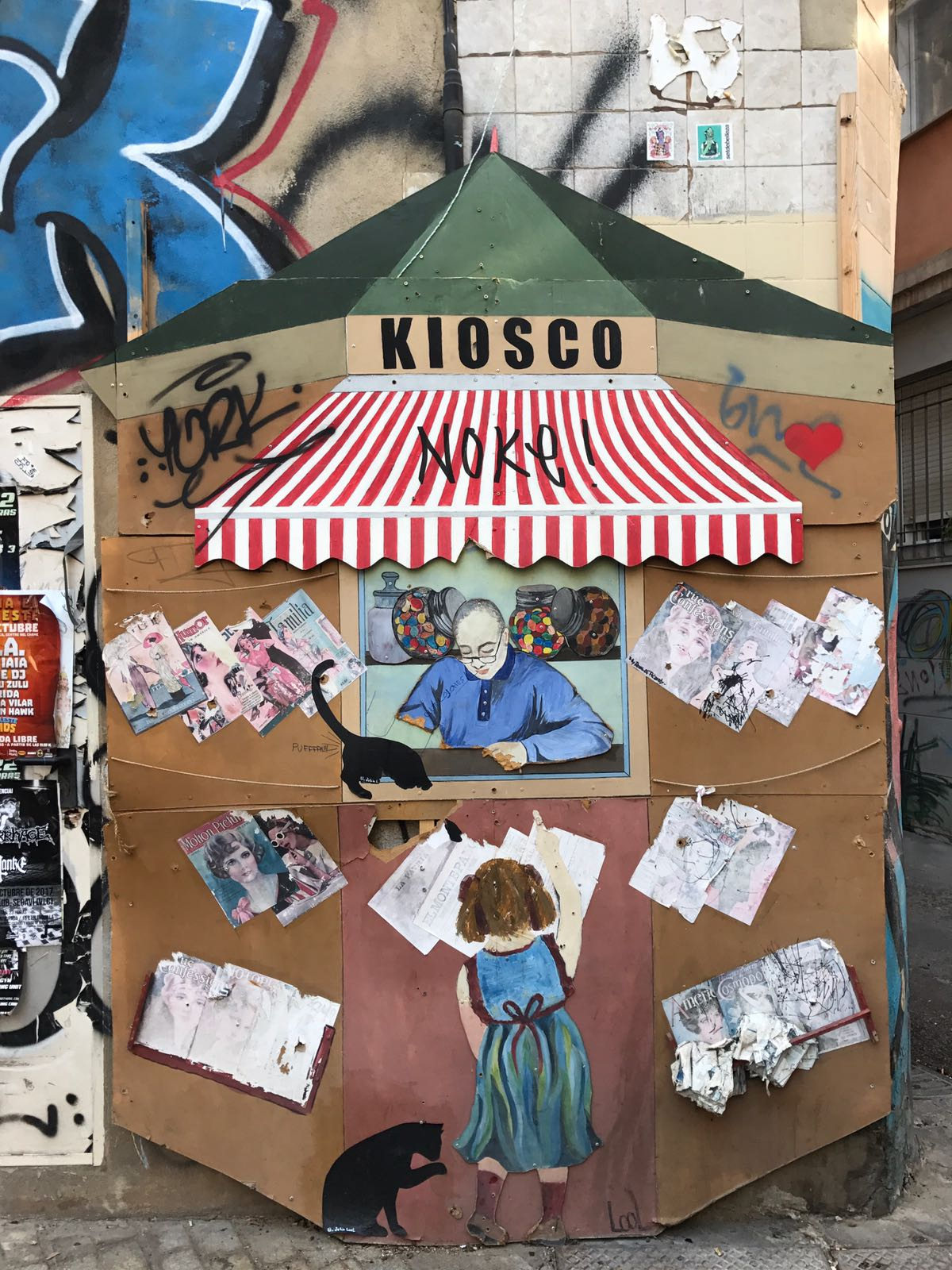 Mural of a kiosk newsagent selling sweets to a little girl