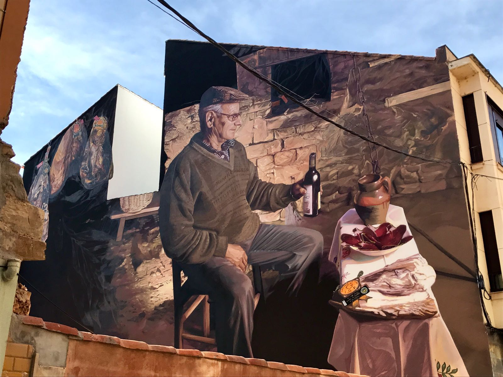 Mural of an old man having lunch in Astorga