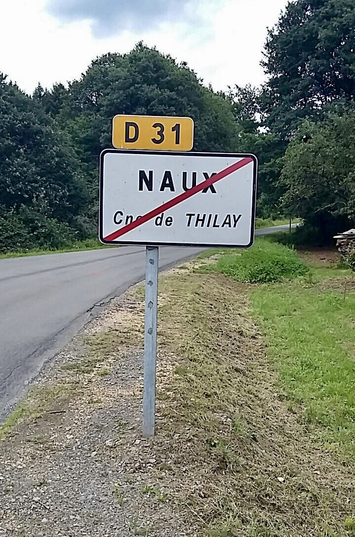 Road sign with Naux crossed out