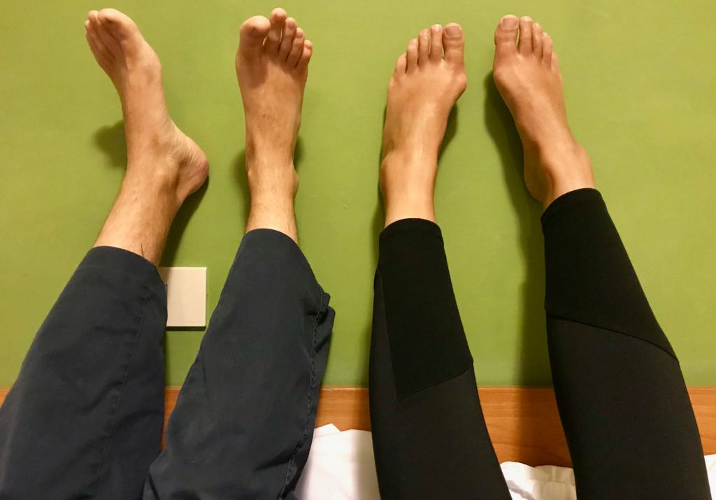 Our legs propped up against the wall after a day of walking