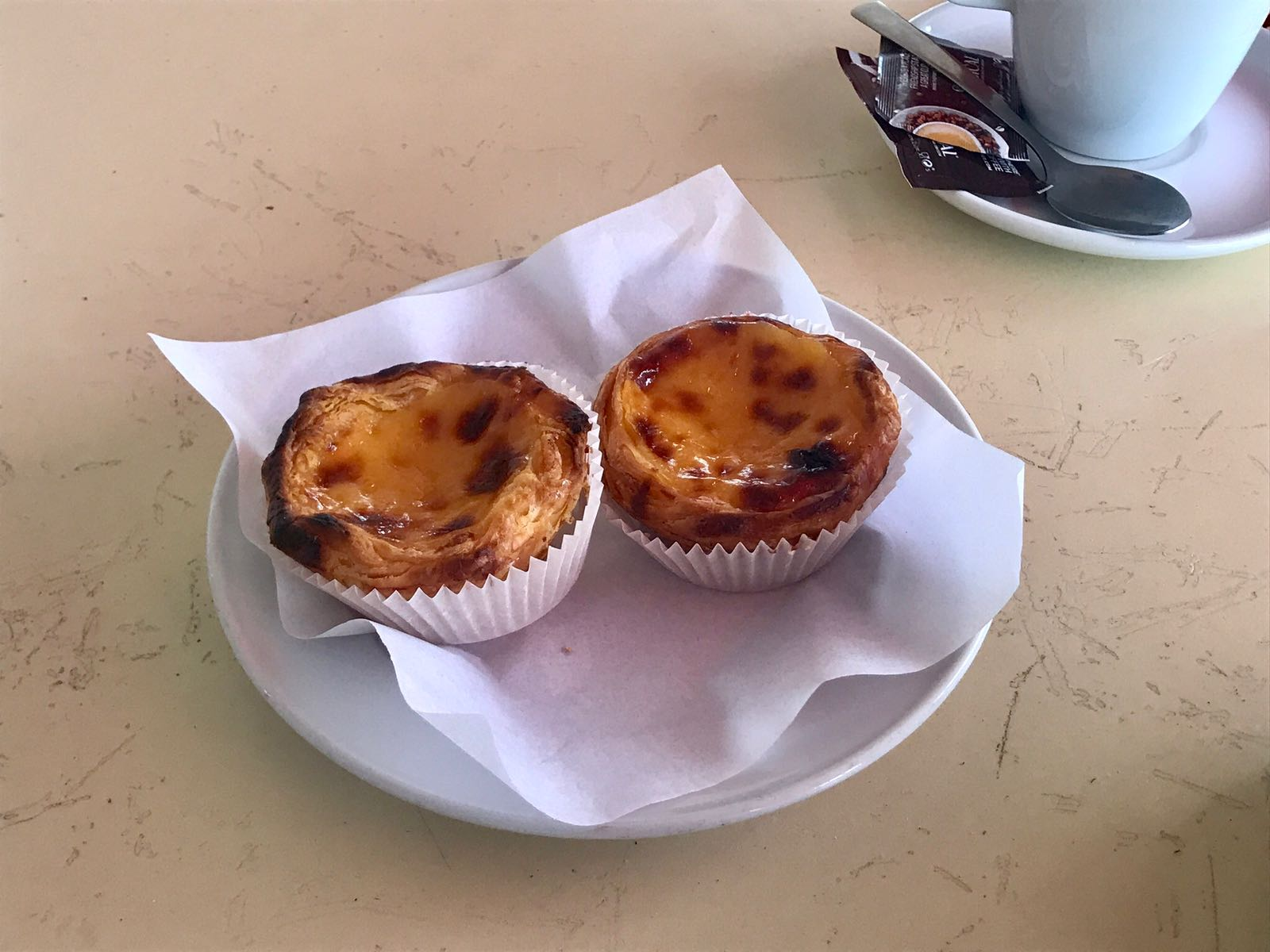 Pastel de nata, a rich custard tart with flaky pastry outside